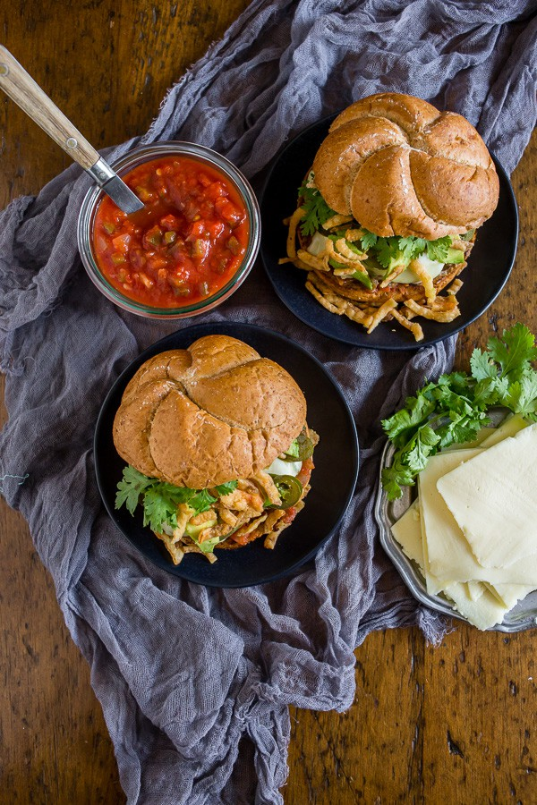 This Baja burger is packed full of fresh summer flavor. The burger patty is studded with fresh jalapeno, lime zest and tons of spices and then it's topped with melty cheese, salsa, pickled jalapenos, crispy fried onions, avocado and cilantro. You're gonna love this burger!