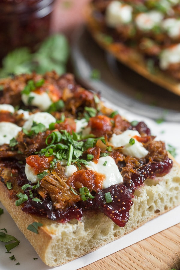 This fig and pig open-faced sandwich is the perfect way to bring flavor to your lunch or dinner. Crusty garlic bread topped with vanilla fig preserves, pulled pork, queso blanco cheese, chipotle salsa, cilantro and green onions.