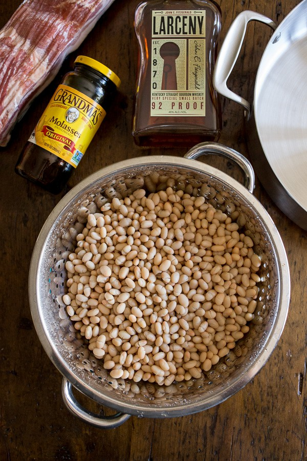 These molasses bacon baked beans are packed full of sweet molasses, maple syrup, bourbon and tons of bacon! If you're not a fan of canned beans this recipe is going to be your new go-to bean recipe! Plus it's ready in just an hour!