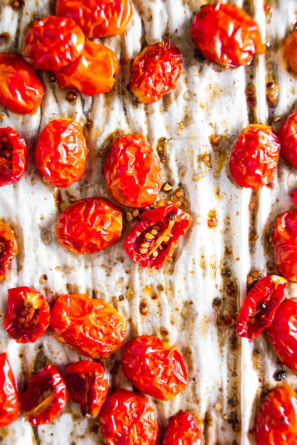 These slow roasted cherry tomatoes are made in the oven and come out sweet and delicious. Ready in 3 hours and perfect for pasta, salad, sandwiches or even for mid-day snacking.