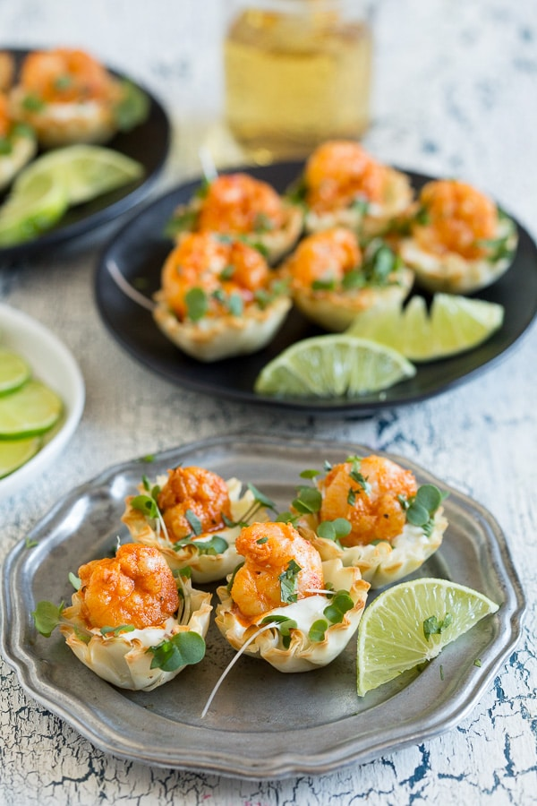 These tequila lime shrimp phyllo cups are the perfect bite size appetizer. Slightly spicy but with a dollop of cooling lime sour cream sauce. You'll love this simple and easy appetizer!