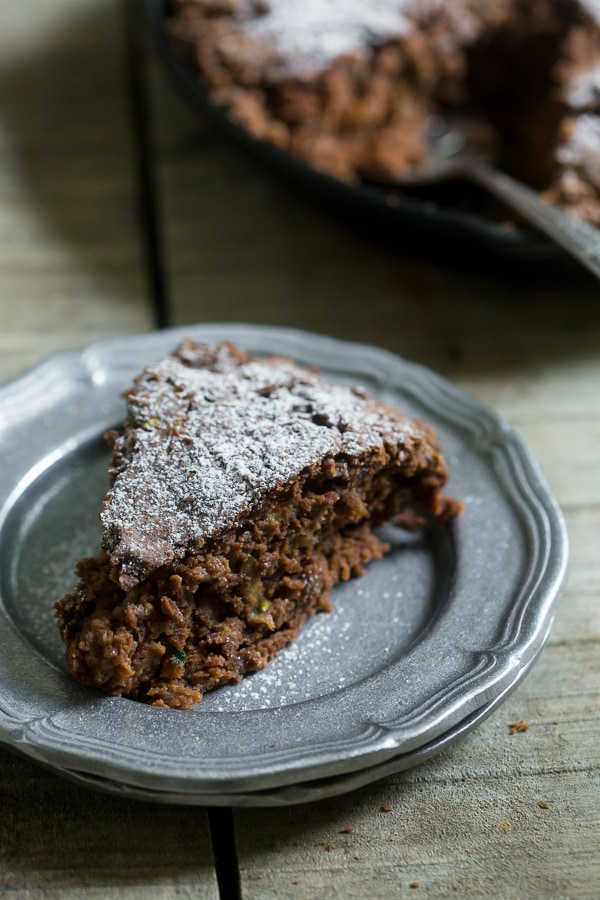 This chocolate zucchini date cake is lightly sweet and full of rich chocolate flavor. Plus it's a great use for all that overflowing garden zucchini. Dust lightly with powdered sugar or serve with a giant scoop of ice cream. The choice is yours!