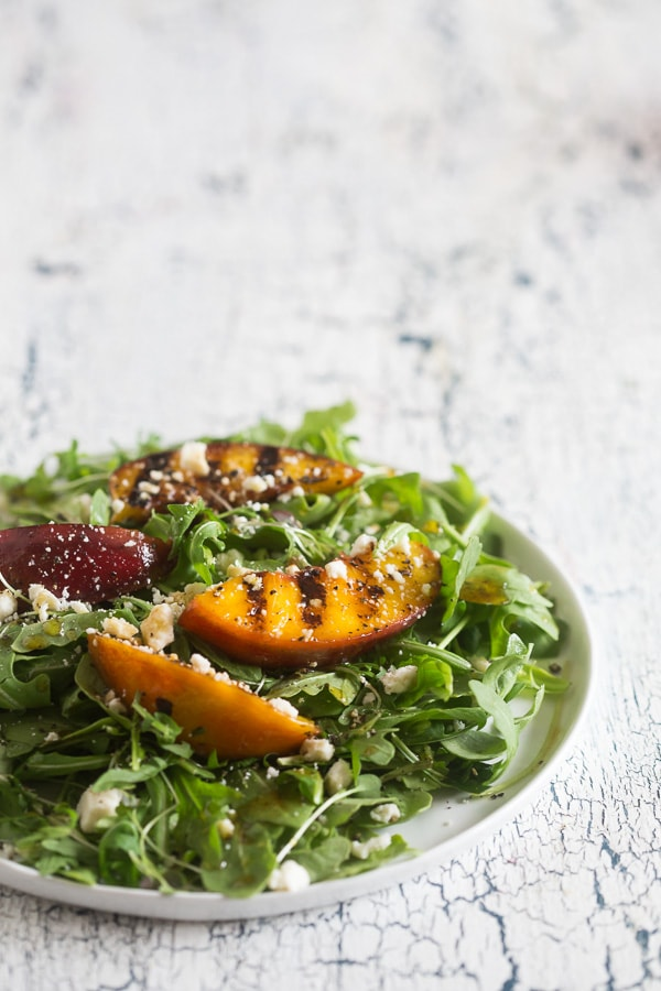 This grilled nectarine salad combines two of my favorite summer things - salads and grilling! Sweet nectarines lightly grilled and tossed into a bed of arugula, ricotta salata and drizzled with a light honey balsamic dressing. You'll love how much flavor is packed into this beauty!
