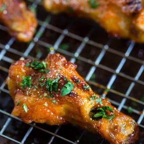 These sweet and spicy honey sriracha chicken wings are the perfect game day appetizer or weeknight dinner. Baked in the oven so they come out super crispy and glazed to perfection.