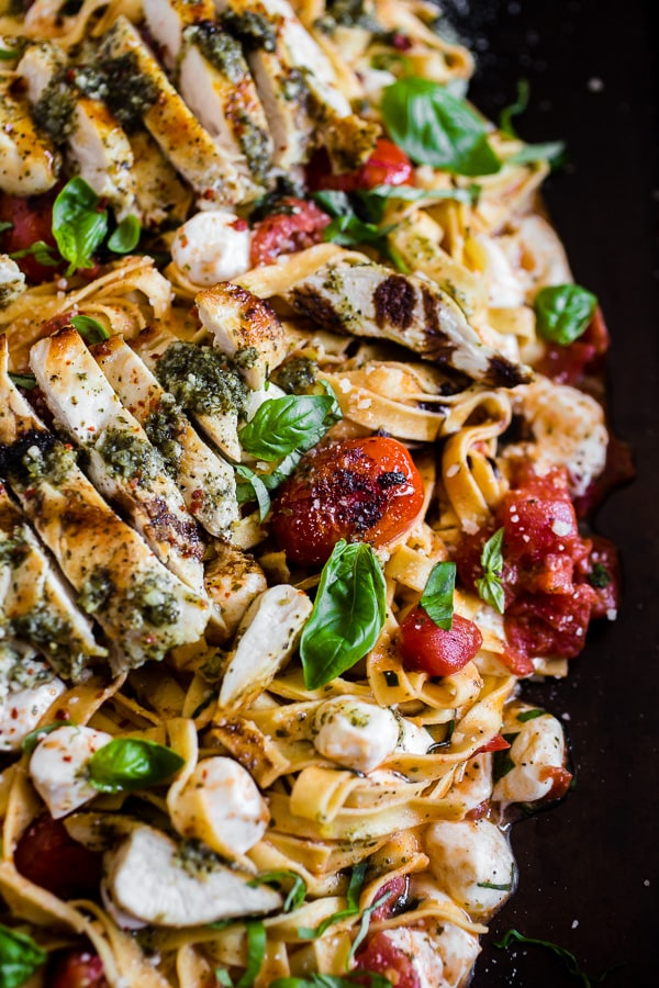 This pesto chicken Caprese pasta is packed full of flavor and packed full of pesto grilled chicken, grape tomatoes, fresh mozzarella and lots of basil. You'll love this fresh pasta not only because it's fresh but because it's easy and ready in just 30 minutes!