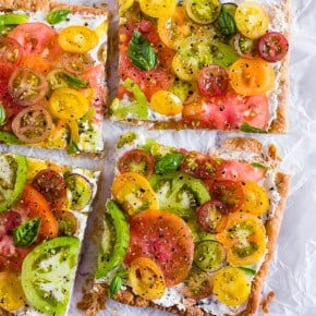 This super simple heirloom tomato tart is made with puff pastry, lemon and fresh herb ricotta and covered with lots of freshly sliced heirloom tomatoes. Ready in just 25 minutes and perfect for an appetizer or a light dinner.