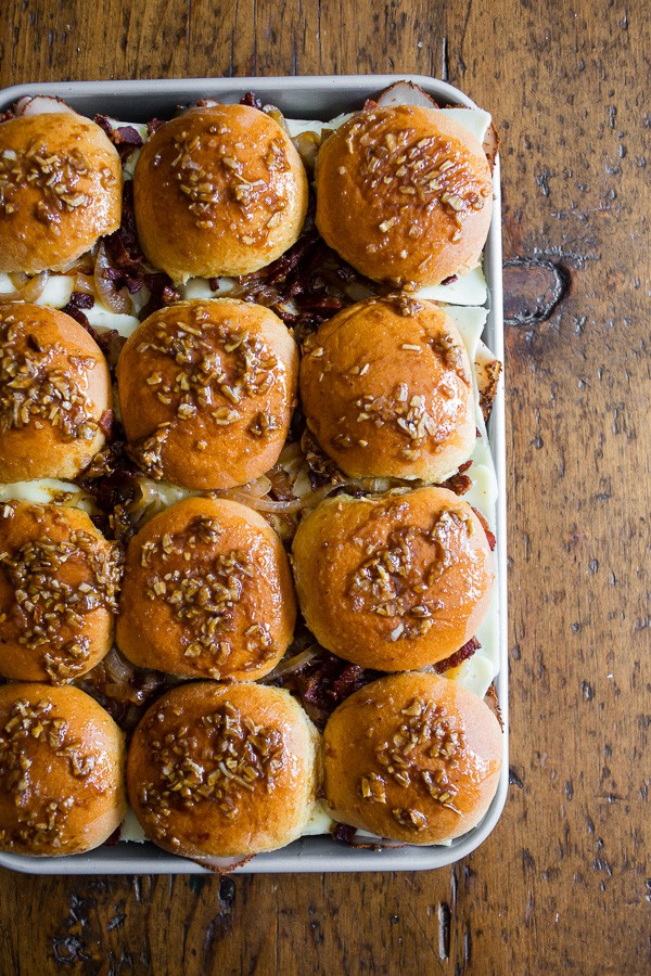 These baked turkey bacon onion sandwiches are the perfect party food. Made with maple mayo and lots of bacon, caramelized onions, cheesy Deli American and turkey. You'll love these delicious sandwiches!