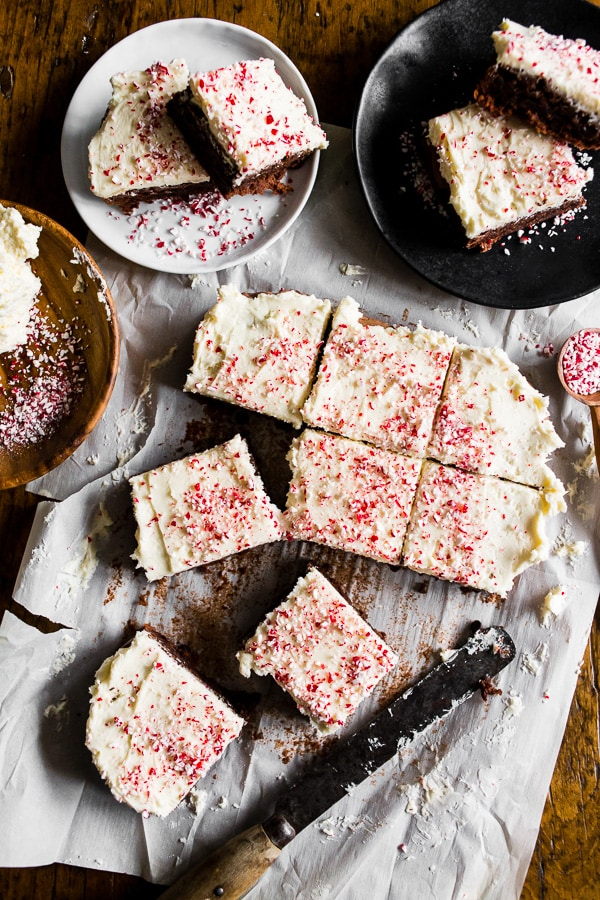 These peppermint hot chocolate brownies are going to be your go-to holiday brownie! Delicious chocolate brownies topped with a homemade marshmallow buttercream flavored with peppermint and vanilla beans. To top it all off I sprinkled the whole thing with crushed candy canes. You're going to LOVE these brownies!