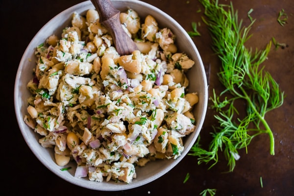 This tuna white bean herb salad is packed full of fresh lemon, herbs and cannellini beans. It's perfect served on toasted bread or while eating straight from the bowl. You'll love how light and easy this tuna salad is to make!