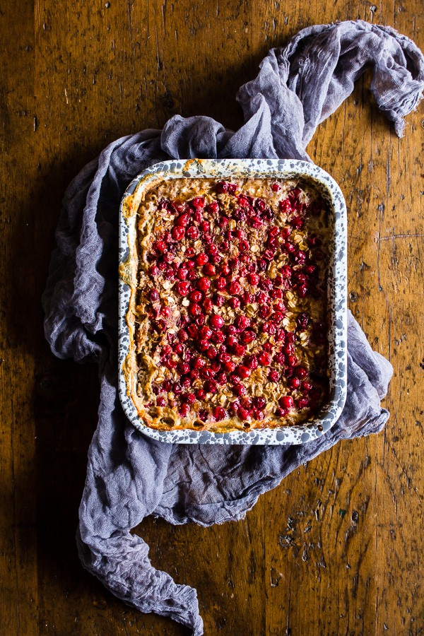 This baked cranberry oatmeal is ready in under an hour and reheats perfectly for a hearty breakfast all week long. Plus it's a great use for all those fall cranberries and delicious maple syrup.