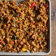 This chorizo sheet pan stuffing is packed full of cornbread, chorizo, peppers, onions and garlic. It's the perfect spicy twist to your normal every day Thanksgiving stuffing. Make your day even easier by prepping the day before and heating up before you feast!