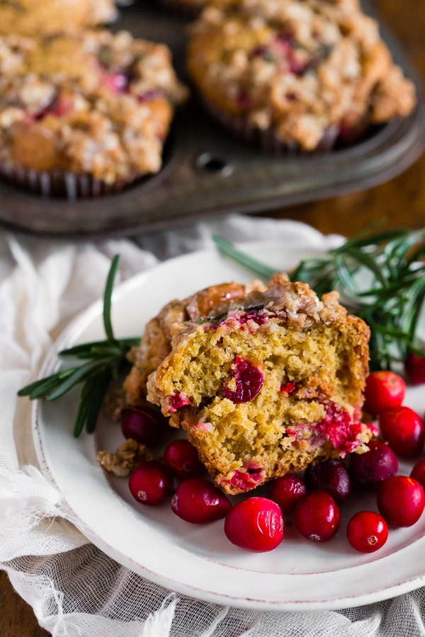 These cranberry orange rosemary muffins are packed full of fresh cranberries, topped with oatmeal streusel and drizzled with an orange glaze. These muffins are the perfect way to start your day and you'll love every single muffin bite.