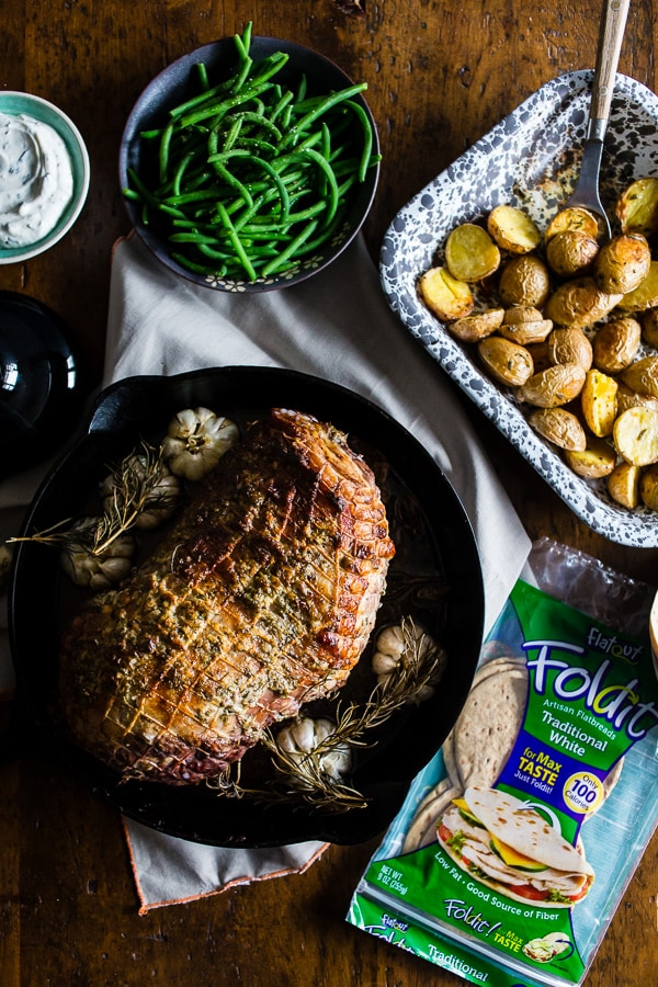 This garlic rosemary roast leg of lamb is the perfect alternative Thanksgiving dinner. Full of garlic and fresh herb flavor and roasted to perfection. Great when served alone or piled high on flat bread with homemade tzatziki sauce.