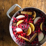 This spiced mulled wine is just what your holiday party needs! Full of red wine, apple cider, whole spices and lots of fresh fruit. You'll love how cozy you'll feel sipping on a mug of this deliciousness.