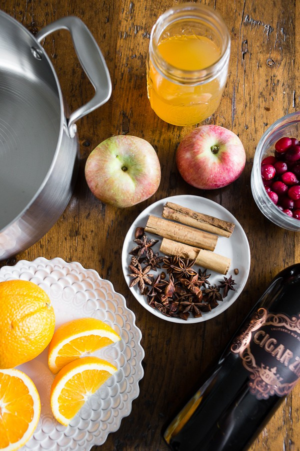 This holiday spiced mulled wine is just what your holiday party needs! Full of red wine, apple cider, whole spices and lots of fresh fruit. You'll love how cozy you'll feel sipping on a mug of this deliciousness.