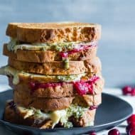 This turkey cranberry pesto panini is the perfect use for all your leftover Thanksgiving turkey and cranberry sauce. Totally delicious and ready in just 15 minutes. You'll love this melty flavor packed panini!