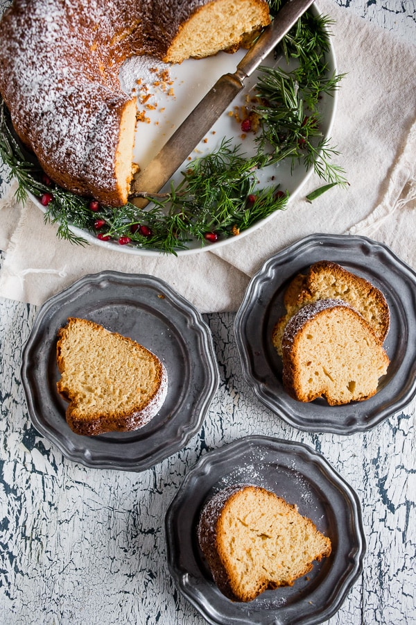 Slices of cream sherry bundt cake sitting on serving plates
