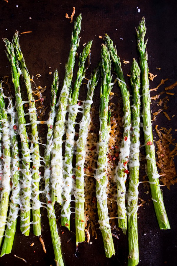 This Parmesan roasted asparagus is sprinkled with Parmesan cheese, crushed red pepper and a little squeeze of lemon. You'll love how simple and delicious this side dish is to make. The best part is the dish is made in just 20 minutes!