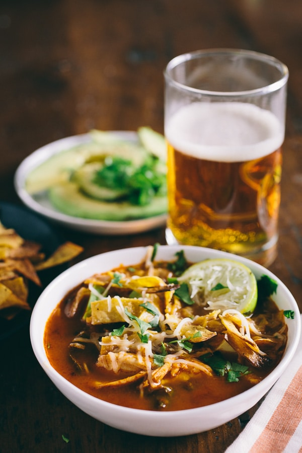 This chicken and chard tortilla soup is the perfect family dinner. Slightly spicy, full of flavor and topped with homemade crunchy tortilla strips.
