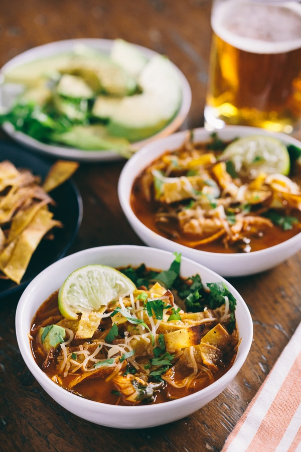 chicken and chard tortilla soup topped with tortilla strips and served with a beer