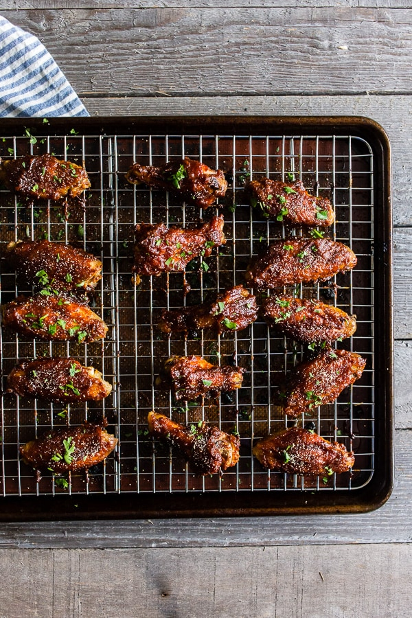 These apple butter honey mustard chicken wings are easy to make, delicious and are the perfect football food. The wings are baked until crispy (no messy frying!) and basted in a homemade apple butter honey mustard sauce. You're going to love these wings!