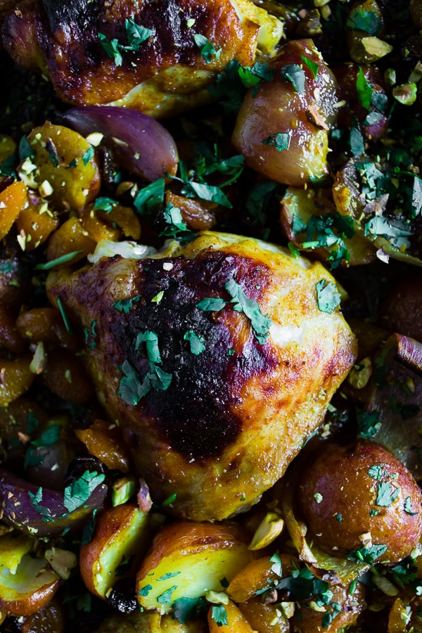 This sheet pan Moroccan chicken and potatoes is flavored with lots of Moroccan spices, dried apricots, golden raisins and a sprinkling of cilantro and pistachios. This dish is super simple to make and only requires 1 sheet pan and 45-50 minutes of roasting!