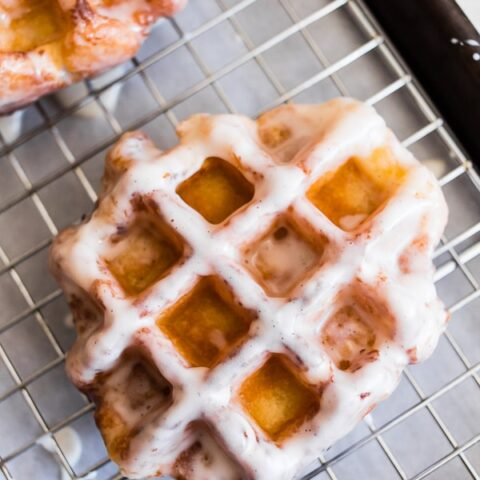 apple butter waffle donuts glazed sitting on a drying rack