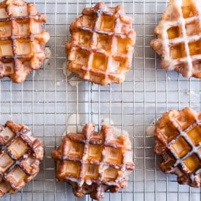 These apple butter waffle donuts are the perfect sweet Easter brunch treat. Perfectly spiced apple butter waffles fried to donuts perfection and dipped in a vanilla bean glaze. You'll love these sweet little donut treats.