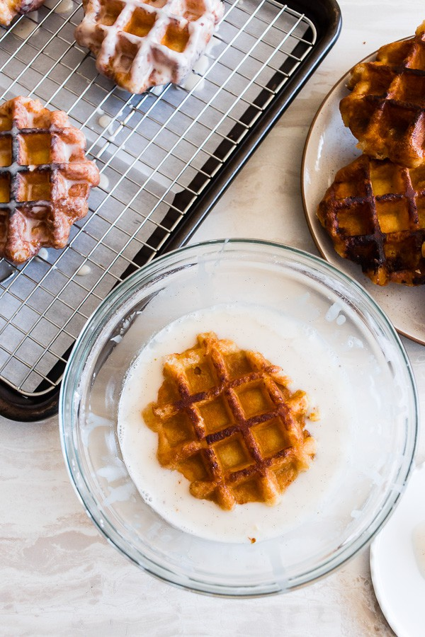 These apple butter waffle donuts are the perfect sweet Easter brunch treat. Perfectly spiced apple butter waffles fried to donut perfection and dipped in a vanilla bean glaze. You'll love these sweet little donut treats.