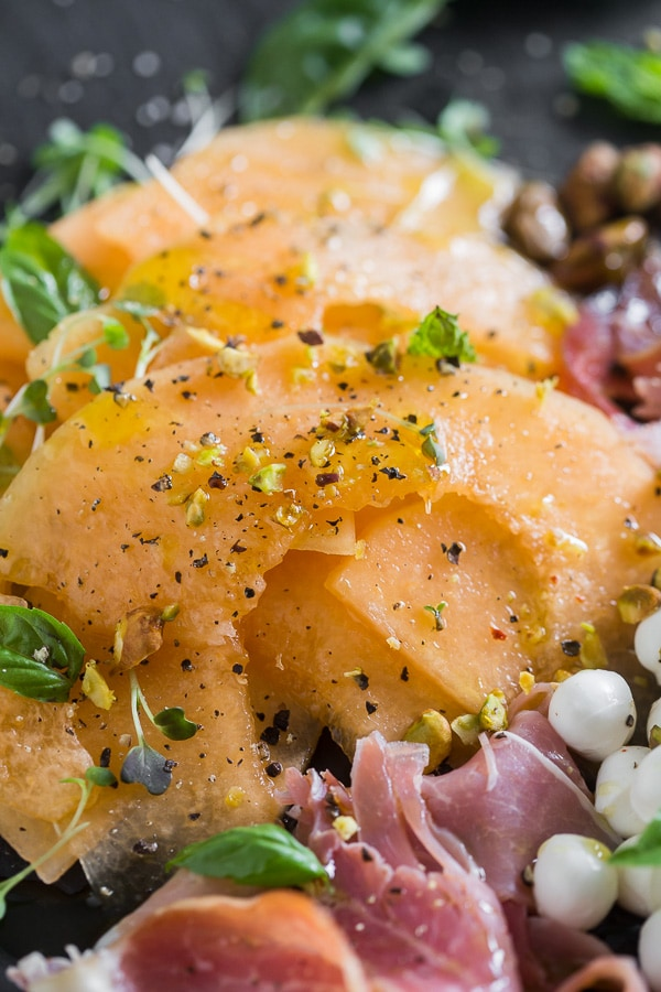 This cantaloupe Prosciutto Caprese salad is the perfect spring and summer salad. Sweet melon mixed with fresh mozzarella, pistachio nuts, Proscuitto, fresh basil and drizzle of honey and olive oil. You're going to love this simple summer salad!