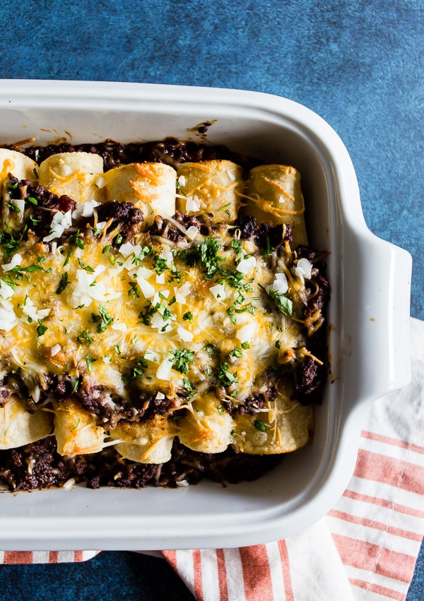 These chipotle beef enchiladas are made with homemade chipotle beef chili and rolled up in corn tortillas and covered with cheddar cheese. The best part is you can make the chili days before making to help cut down on prep time. If you have never made enchiladas before now is the time!