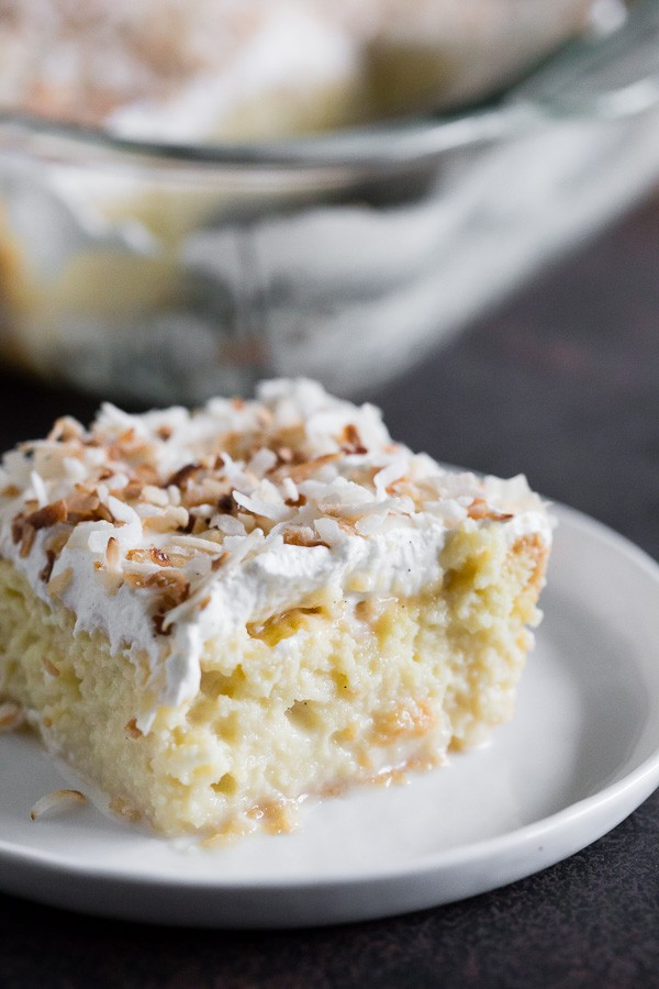 You're going to go crazy over this toasted coconut tres leches cake. To jazz it up I used creamy coconut milk, coconut rum, spiced rum AND toasted coconut. This is the tres leches cake of your dreams!