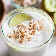 This coconut lime frozen margarita is just what your summer ordered! PACKED full of sweet coconut flavor and jazzed up with zippy lime juice. Instead of salt, I opted to rim the cocktail with lime sugar and top it with toasted coconut.