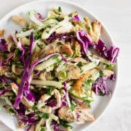 This crispy chicken apple cabbage salad is guaranteed to be your new favorite salad. It's made super easy by using rotisserie chicken and crisping it up in olive oil with lemongrass, ginger, and garlic. That's combined with lots of fresh chopped cabbage, minced herbs, apples and a light squeeze of lime.