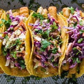 These easy fish tacos with citrus Greek yogurt slaw are the perfect busy weeknight meal. Super crispy fish topped with a crazy easy cabbage slaw made with Greek yogurt and lime juice. You'll love how easy these tacos come together!