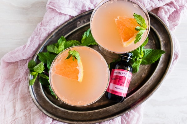 This grapefruit Campari rose water cocktail is your new summertime jam! Light and refreshing with soft subtle floral notes. You'll love all the flavor packed in this cocktail!