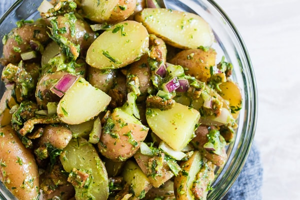 This herbed Dijon mustard potato salad is the perfect summertime salad. It's packed full of flavor and lots of crispy bacon. Plus it's mayonnaise free so it's perfect for outdoor picnics and parties!