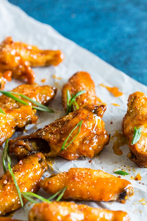 These pineapple mango habanero chicken wings are the perfect summertime appetizer or easy dinner! They're a delicious mix of sweet and spicy and can be made in your oven or the grill. It's time to give into your chicken wing cravings!