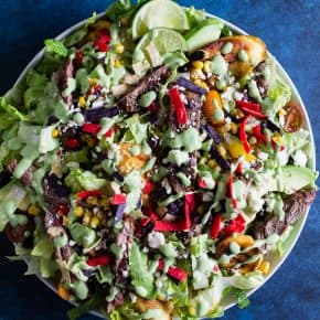 This southwest steak salad with fried plantains is crazy delicious and super easy to make! It's a straight up dinner salad PACKED with grilled steak, fried plantains, black beans, corn, tomatoes, avocado, crunchy tortilla strips and all drizzled with a homemade Greek yogurt cilantro dressing. This salad is super filling and perfect for warm summer nights.