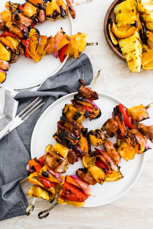 These grilled sweet and sour turkey kebabs are the perfect summertime grilling recipe. Delicious turkey chunks skewered with pineapple, orange slices, bell peppers, red onion and glazed with a homemade sweet and sour sauce. Plus these beautiful kebabs cook up in just 20 minutes!