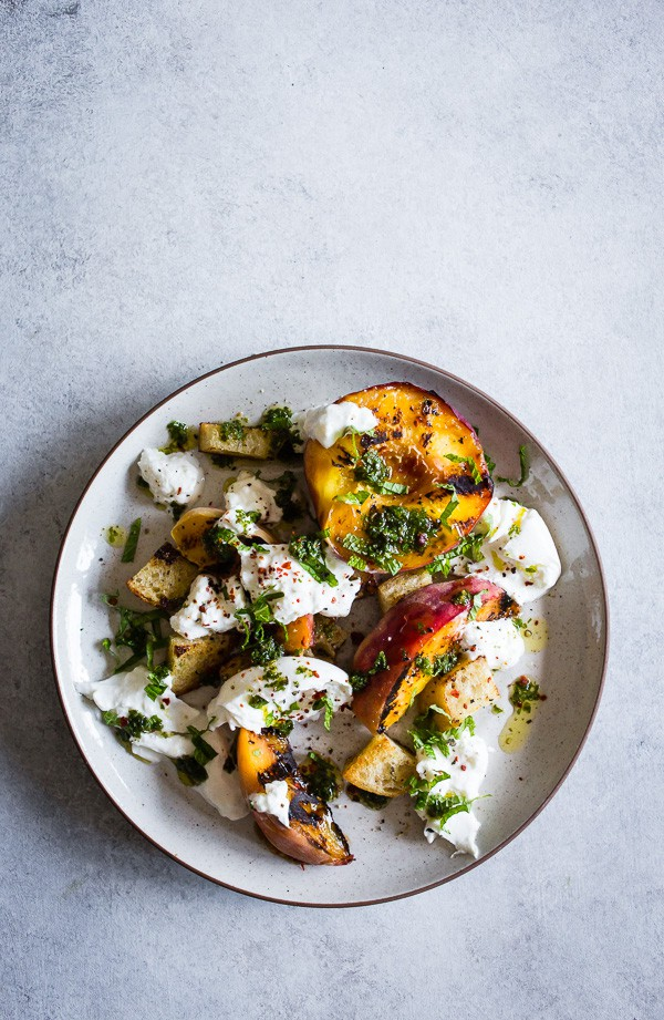 overhead look at a plate topped with grilled peach burrata salad