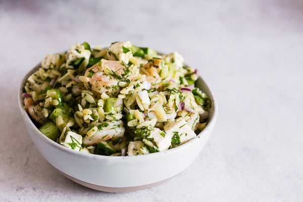 This herbed shrimp orzo salad is packed full of lemon flavor, fresh herbs, cucumbers, red onion, salty feta and perfectly cooked garlic shrimp. This pasta salad is super easy to make and makes a great light summer meal or flavorful side dish.