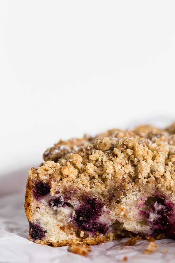 This mixed berry coffee cake is perfect for breakfast or dessert. Tender cake made with Greek yogurt, filled with fresh picked black raspberries and blackberries and topped with a crunchy brown sugar crumbly topping. This cake is perfect for summer!