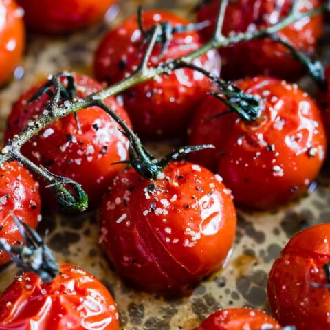 These on the vine roasted tomatoes are the packed full of flavor and the perfect use for all your summer tomatoes. Perfectly roasted and great on salads, thrown in pasta or just eaten plain. So simple and easy to make!