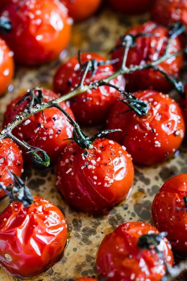 cooked on the vine roasted tomatoes in a metal baking dish.