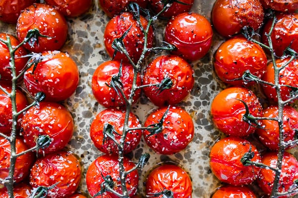 cooked on the vine roasted tomatoes in a pan.