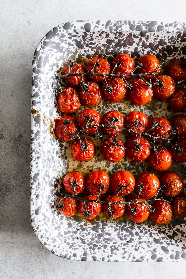 a tray full of on the vine roasted tomatoes