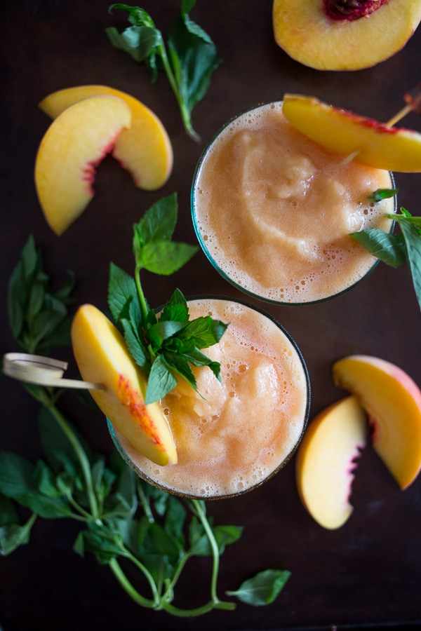 These peach tea bourbon slushies are the perfect summer addition. Full of peach tea, bourbon and lots of fresh peaches. This cocktail is summer perfection!