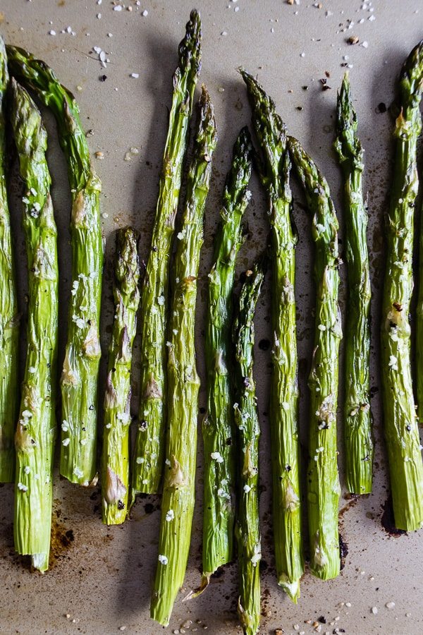 This roasted asparagus is perfectly seasoned and the perfect side dish. Made with just 4 ingredients and ready in just 15 minutes. You'll love how easy it is to go from boring asparagus to CRAZY GOOD asparagus.