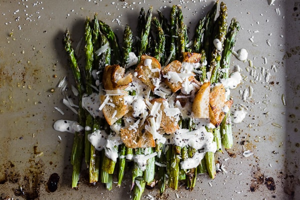 This roasted asparagus Caesar salad is packed full of flavor and a great twist to classic roast asparagus. Plus you'll love the homemade Greek yogurt caesar dressing!